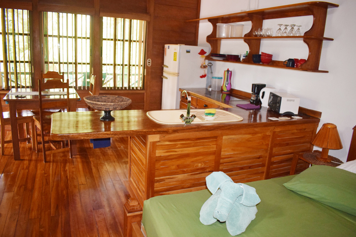 Bedroom, kitchen and dining room at Giardino Tropicale.