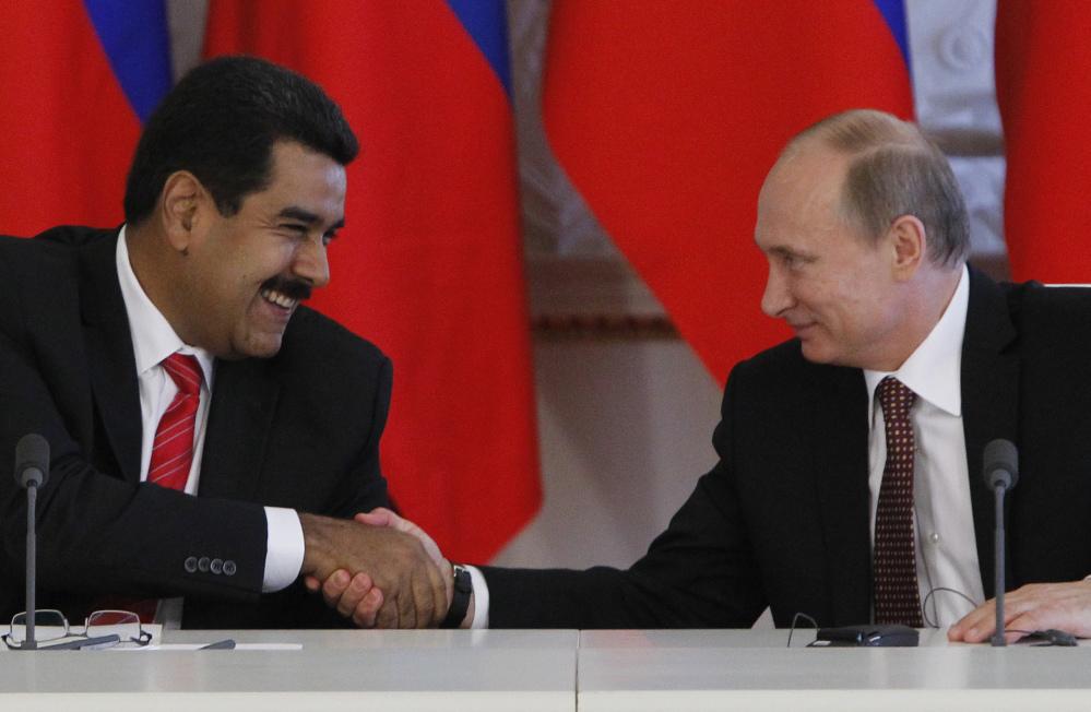 Russia President Vladimir Putin, right, and Venezuelan counterpart Nicolás Maduro