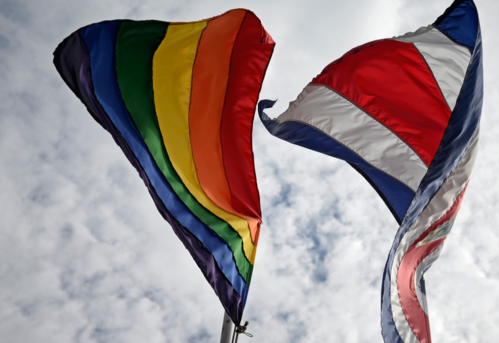 The rainbow flag of the LGBT right movement flies next to the Costa Rican flag at Casa Presedencial. President Luis Guillermo Solís raised the flag in honor of the International Day Against Homophobia on May 17, 2014.