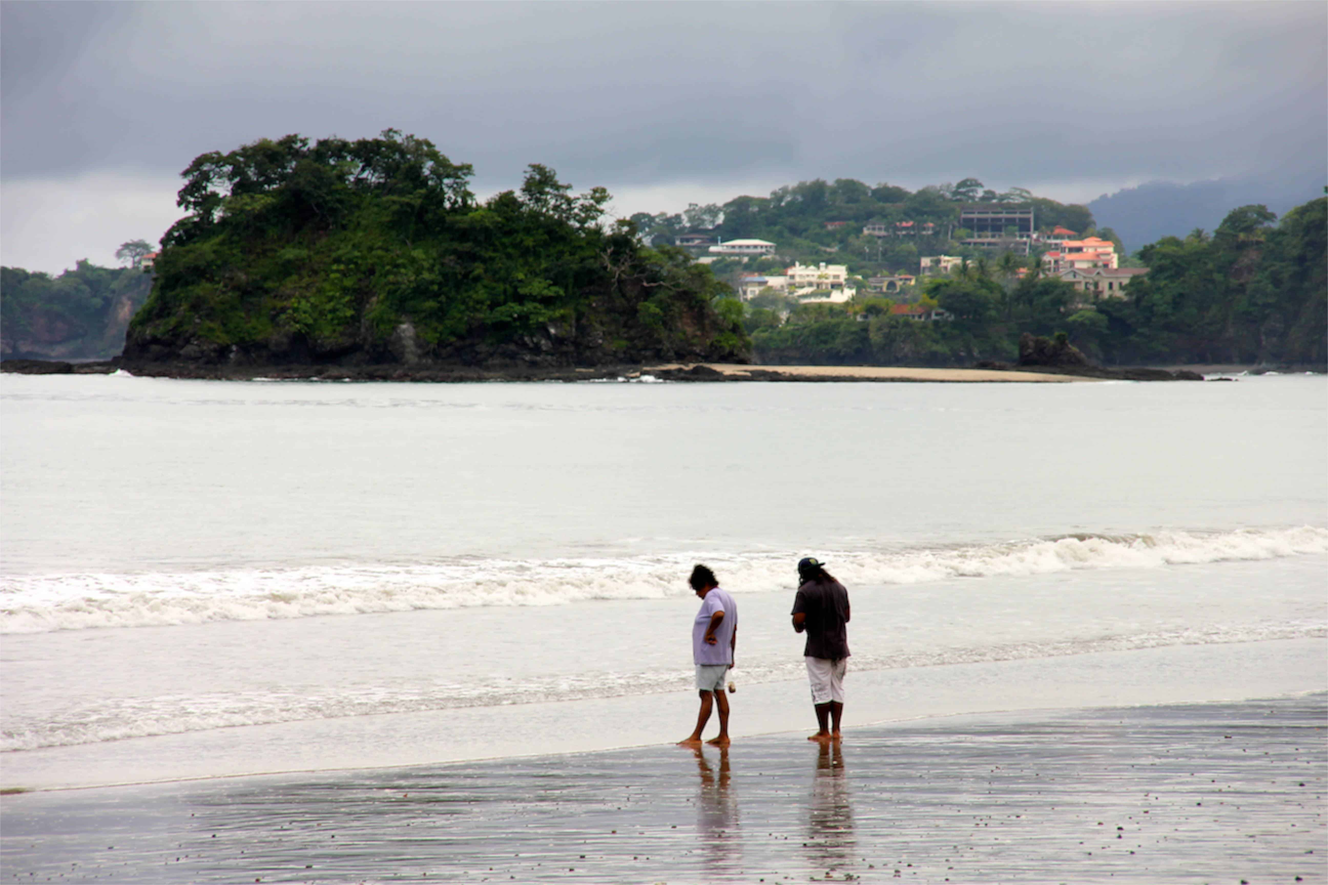 Beachgoers stroll the sands of Brasilito's bay.