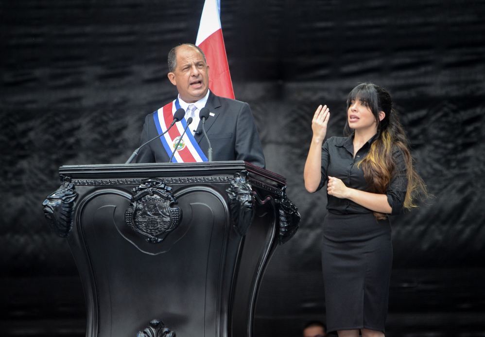 Estefanía Carvajal, right, signs President Luis Guillermo Solís' inauguration speech on May 8, 2014.