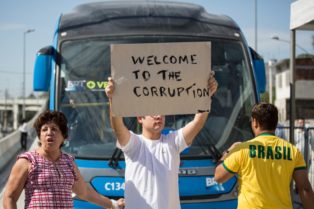 Brazilians protest during the inauguration of the BRT's new line.