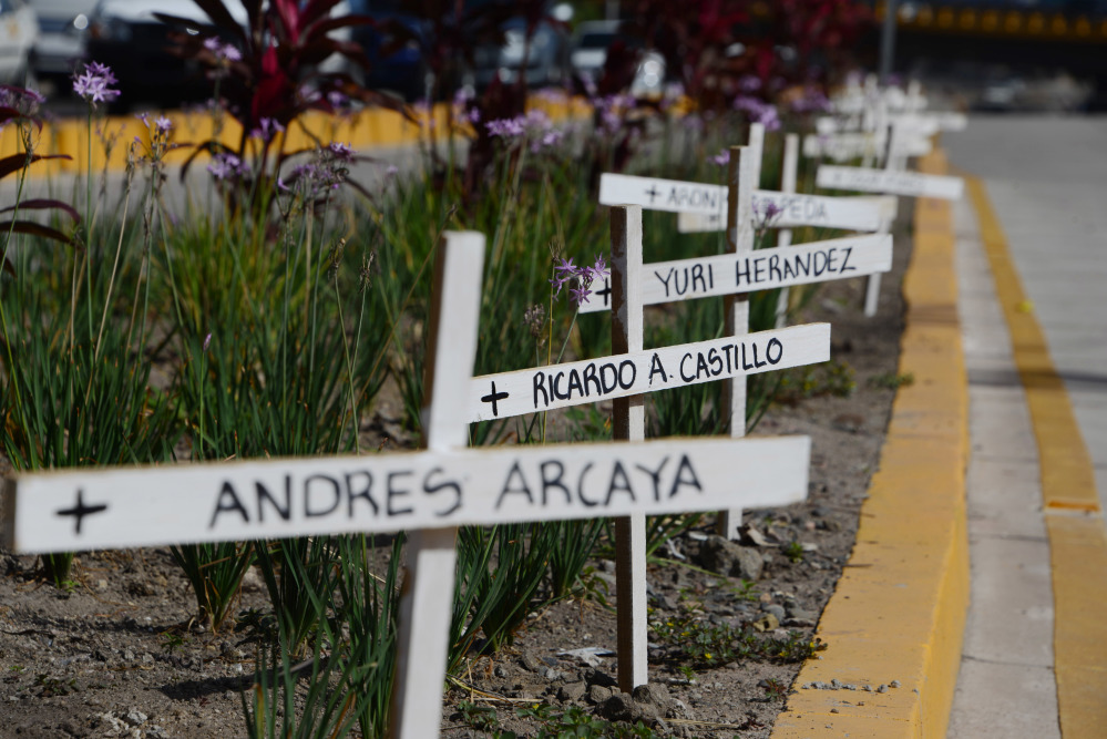 White crosses in memory of victims of violence are seen around Tegucigalpa.