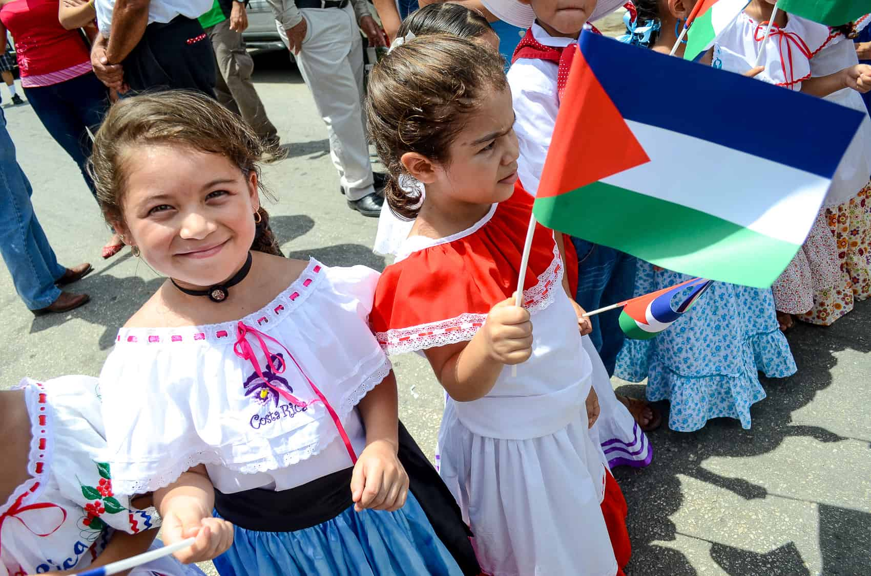 Children in traditional dress wave the Guanacaste flag at the 190th anniversary of the annexation of the Partido de Nicoya by Costa Rica, 2014.