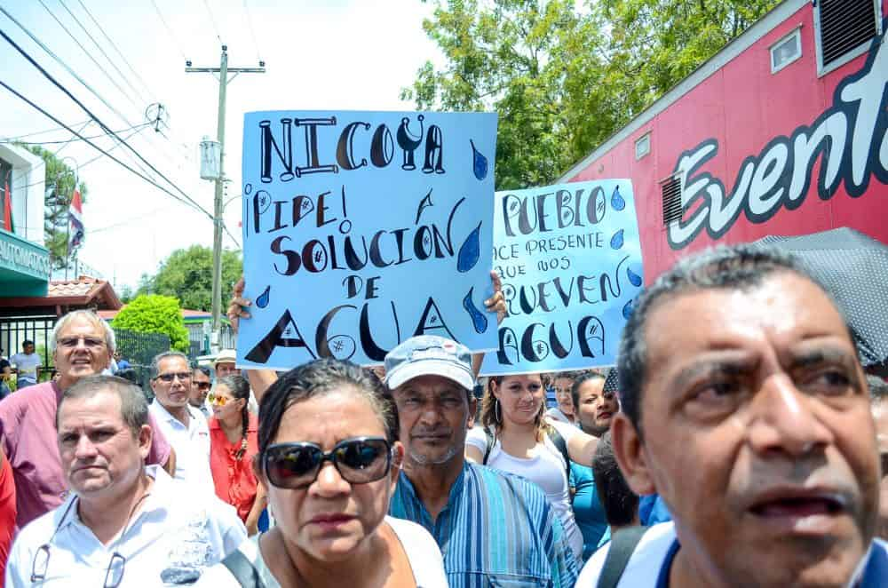 Protesters at the Nicoya annexation anniversary demand a solution for the water crisis in the Guanacaste province. Water in some regions had been contaminated with arsenic, and the province is also in the midst of a drought, July 25, 2014.