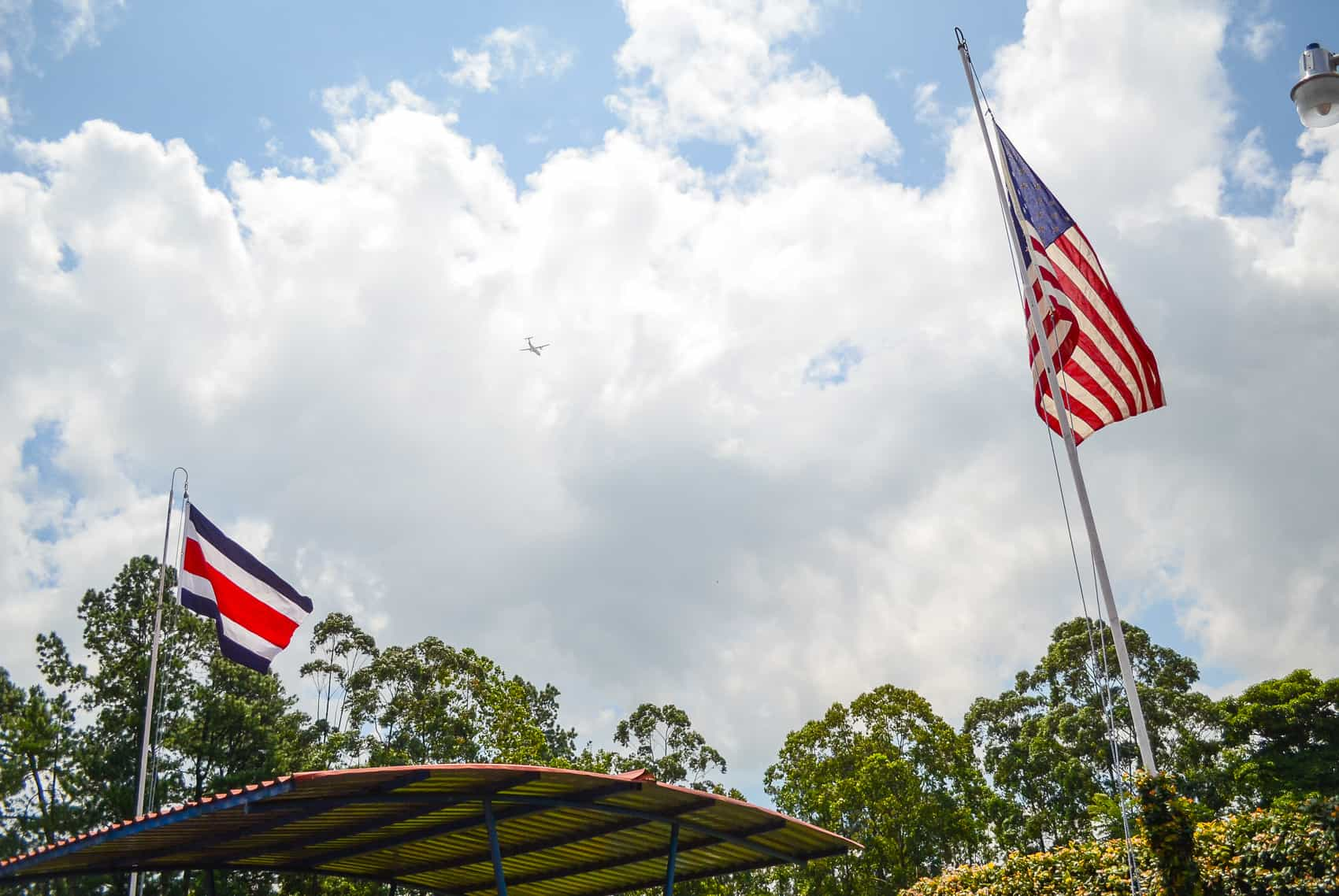The Costa Rican and U.S. flags flying side-by-side.