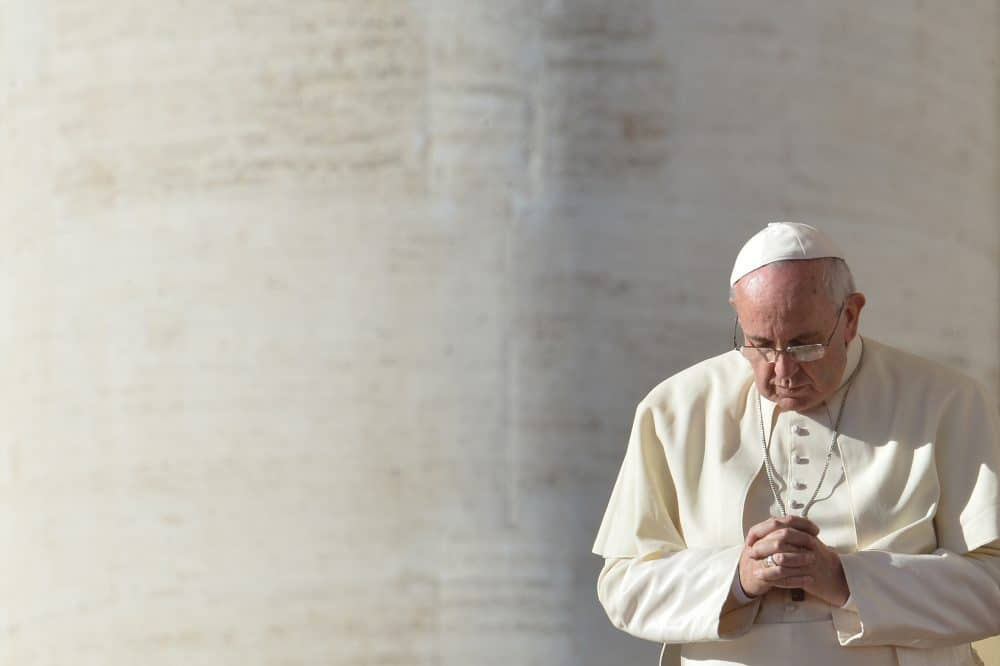 Pope Francis prays at St. Peter's square during his general audience on Dec. 17, 2014 at the Vatican.