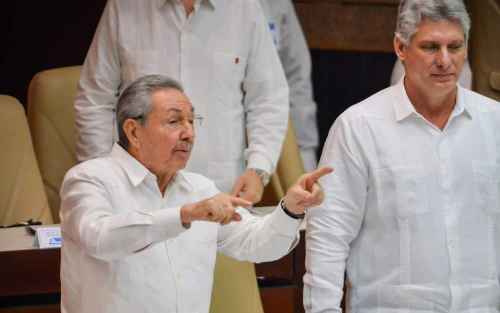 Cuban President Raúl Castro, left, gestures next to first Vice President Miguel Díaz-Canel at the end of the annual session of parliament on Dec. 20, 2014 in Havana.