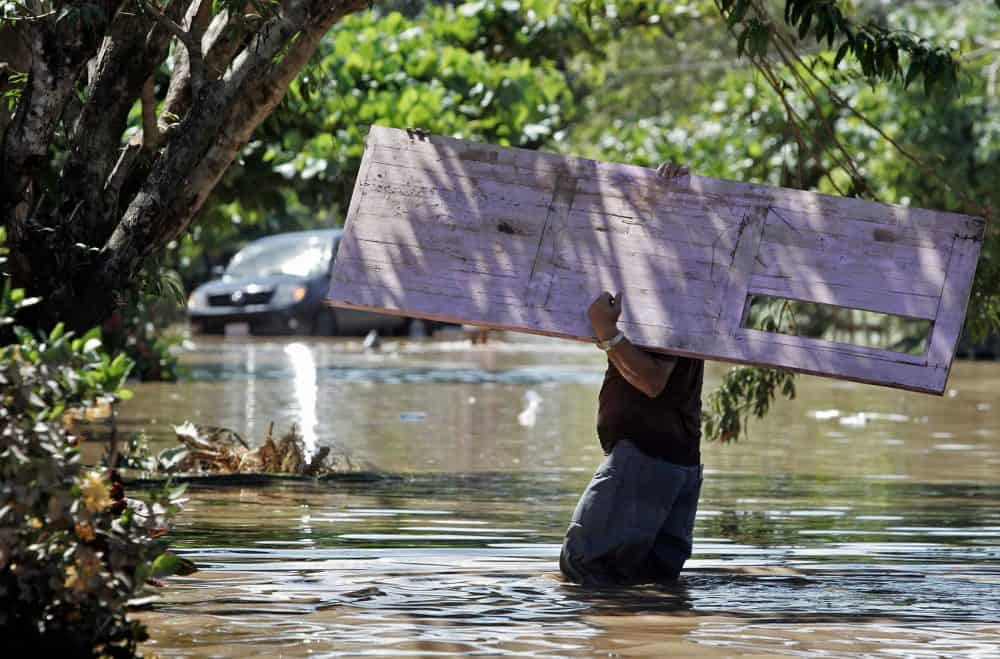 A man carries a door to his home on May 30, 2008, in the locality of Sitradique