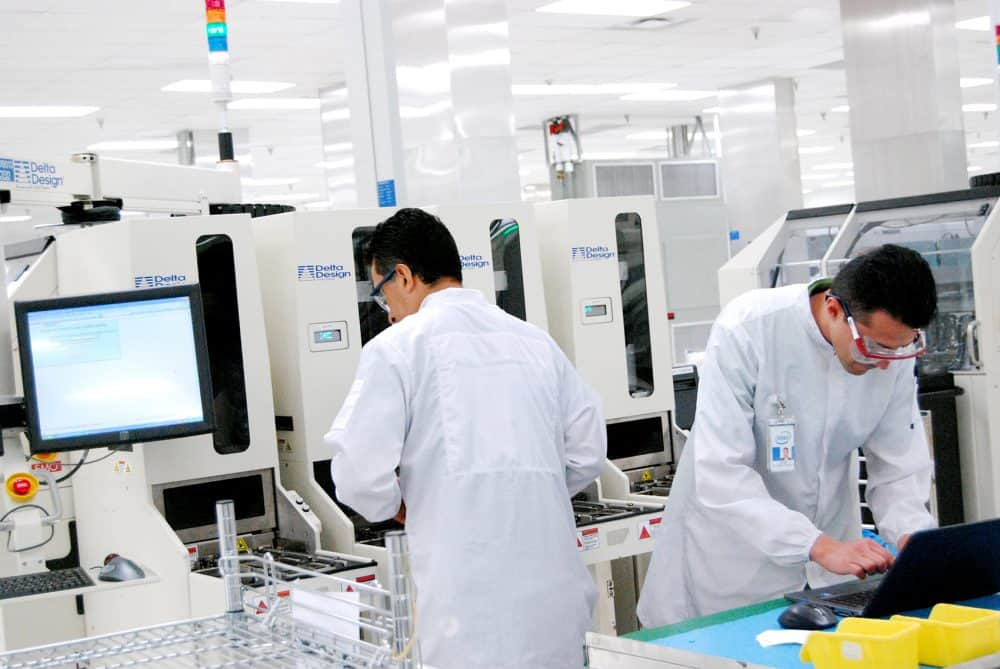 """Workers at Intel's new quality control """"mega laboratory,"""" inaugurated Dec. 17, 2014."""