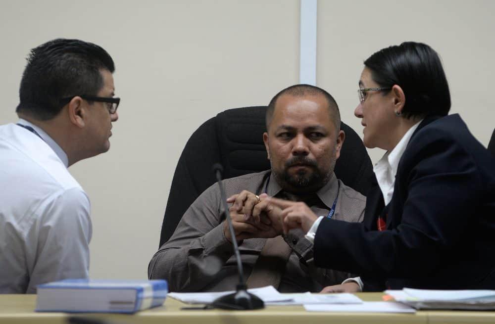 From left, judges Luis Rodríguez Arauz, Hernán Salazar and Yolanda Alvarado discuss evidence during the Jairo Mora murder trial in Limón, Costa Rica, on Jan. 12, 2015.