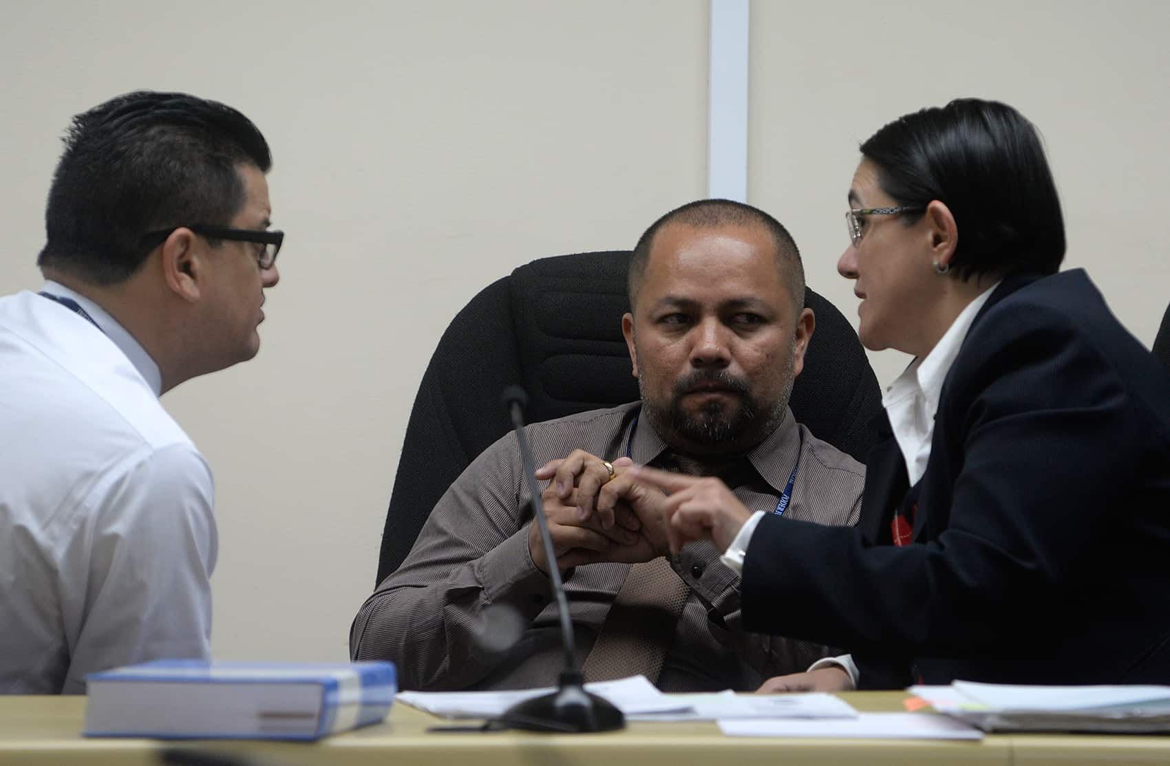 From left, judges Luis Rodríguez Arauz, Hernán Salazar and Yolanda Alvarado discuss evidence during the Jairo Mora murder trial in Limón, Costa Rica, on Jan. 12, 2015.