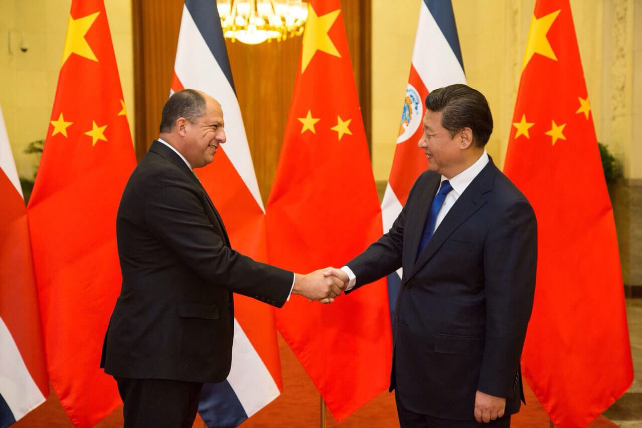Costa rica china to explore creation of special economic zones costa rican president luis guillermo sols left shakes hands with chinese president xi jinping during an official state visit to beijing on tuesday jan m4hsunfo
