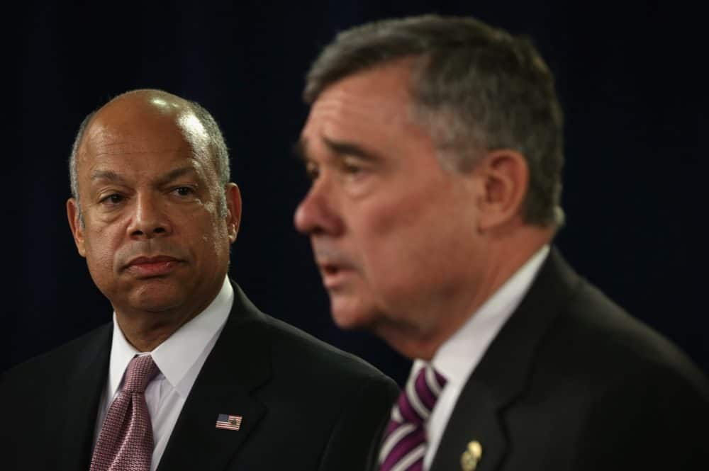 U.S. Secretary of Homeland Security Jeh Johnson (L) looks on as Gil Kerlikowske (R), Commissioner of U.S. Customs and Border Protection, speaks during a news conference February 23, 2015 in Washington, DC.