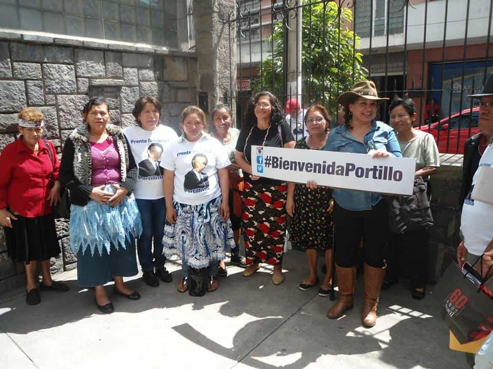 "Supporters of former Guatemalan President Alfonso Portillo pose with a ""Welcome Portillo"" sign. Posted Feb. 24, 2015."