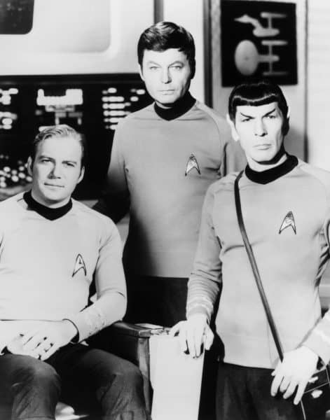 "William Shatner, left, DeForest Kelley, center, and Leonard Nimoy pose on the set of the television series ""Star Trek"" in this undated photo."