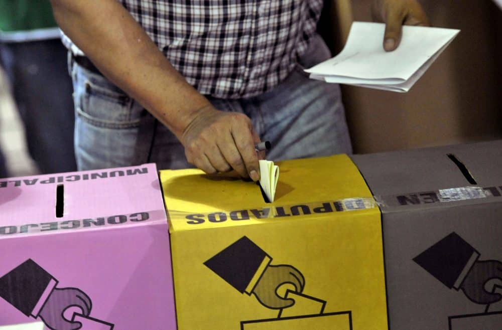 A man casts his vote during legislative and municipal elections on March 1, 2015 in San Salvador.