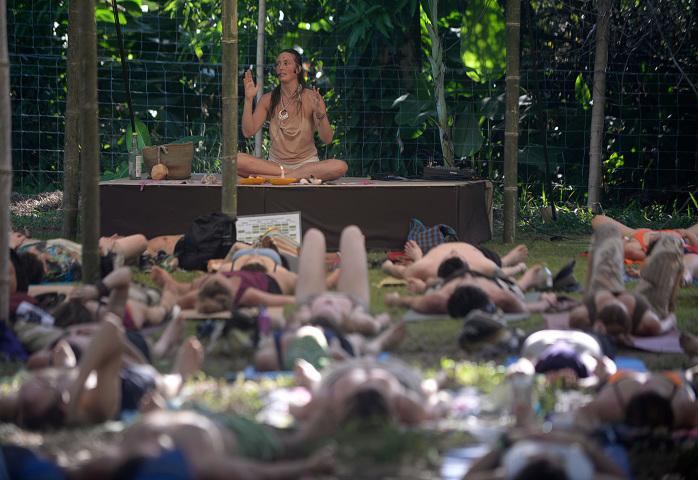 A teacher leads a yoga class.