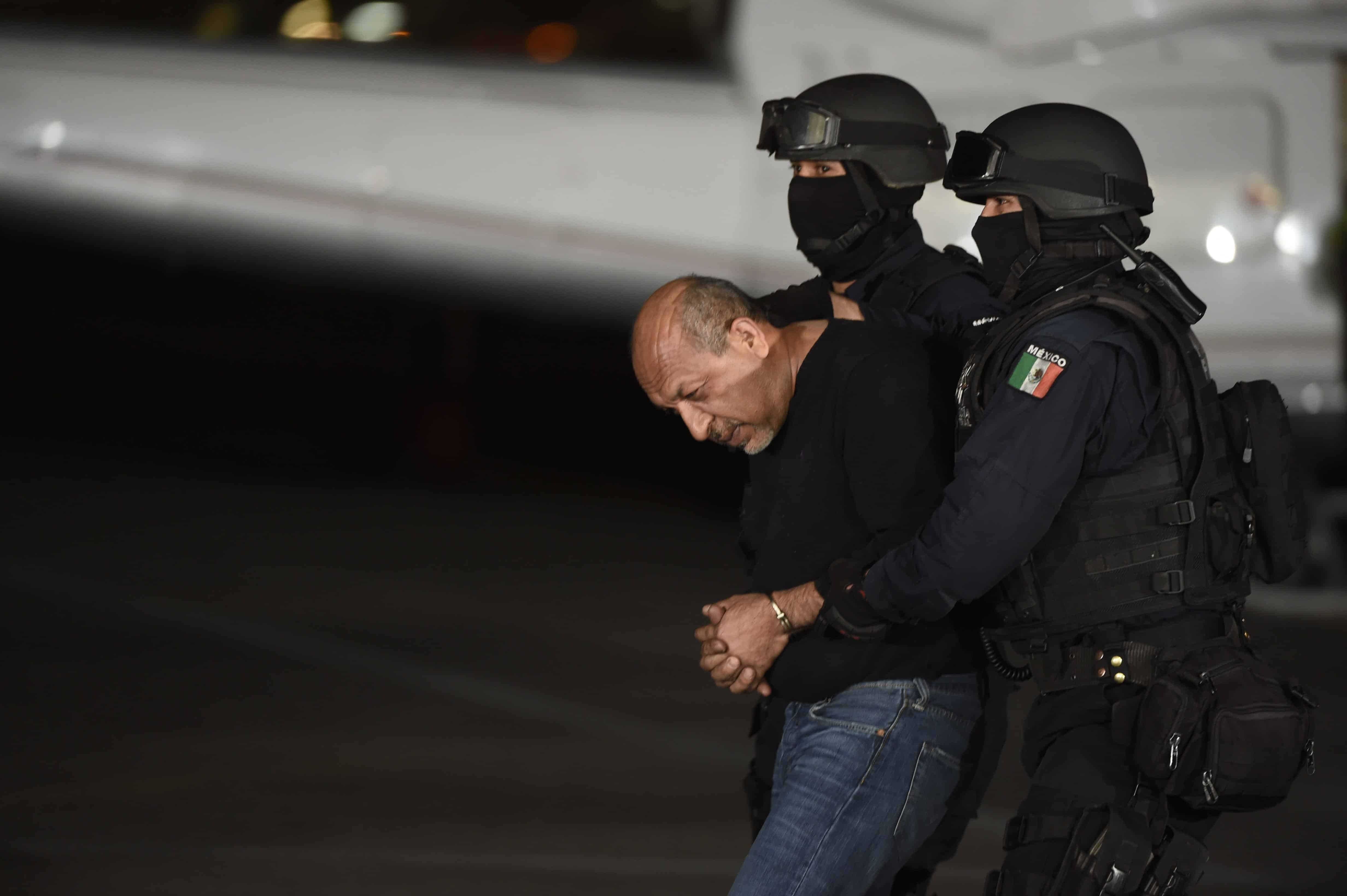 "Mexican federal police escort Servando Gómez, aka ""La Tuta,"" to jail."