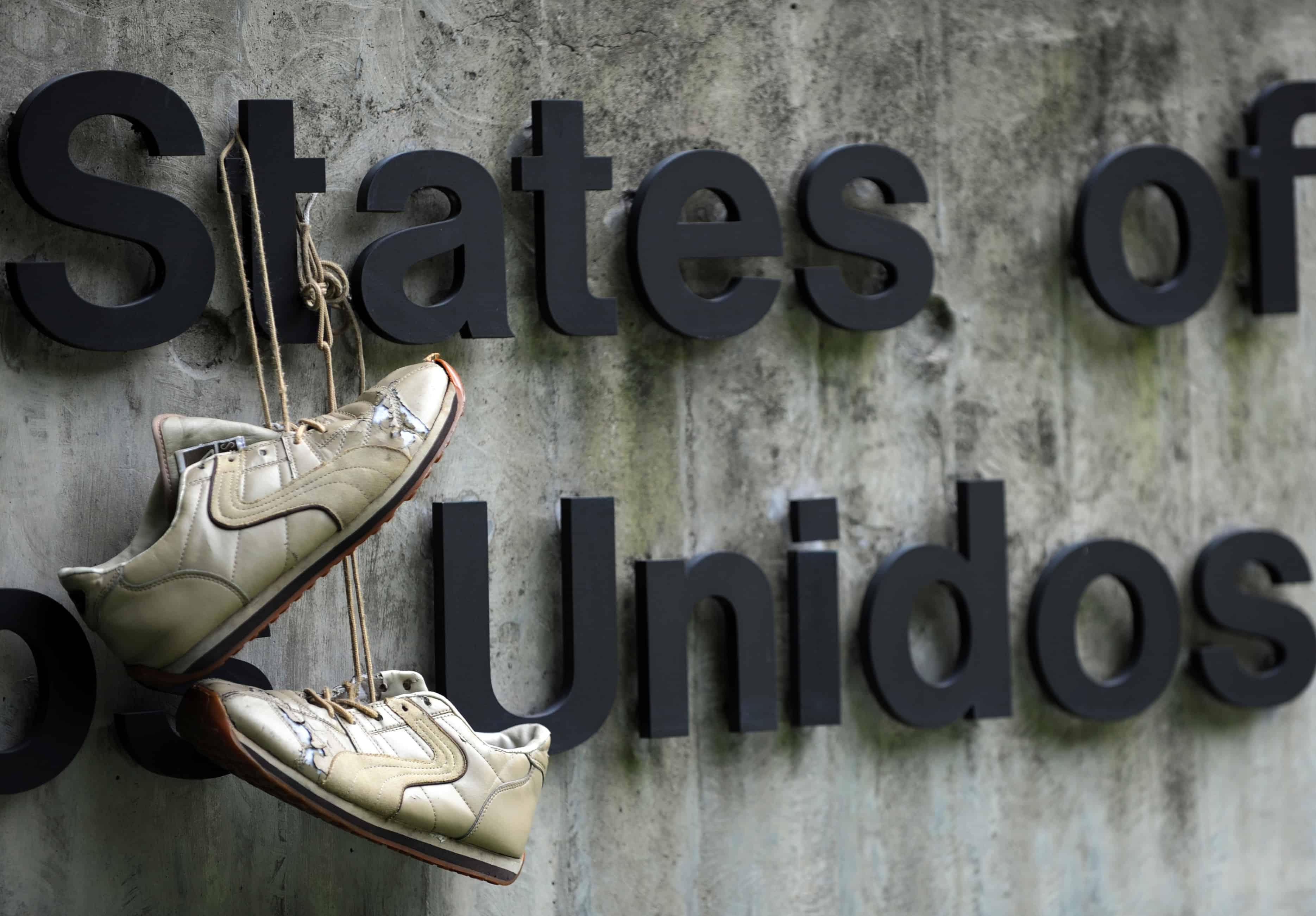 A pair of shoes hang at the U.S. Embassy in Caracas in 2008.