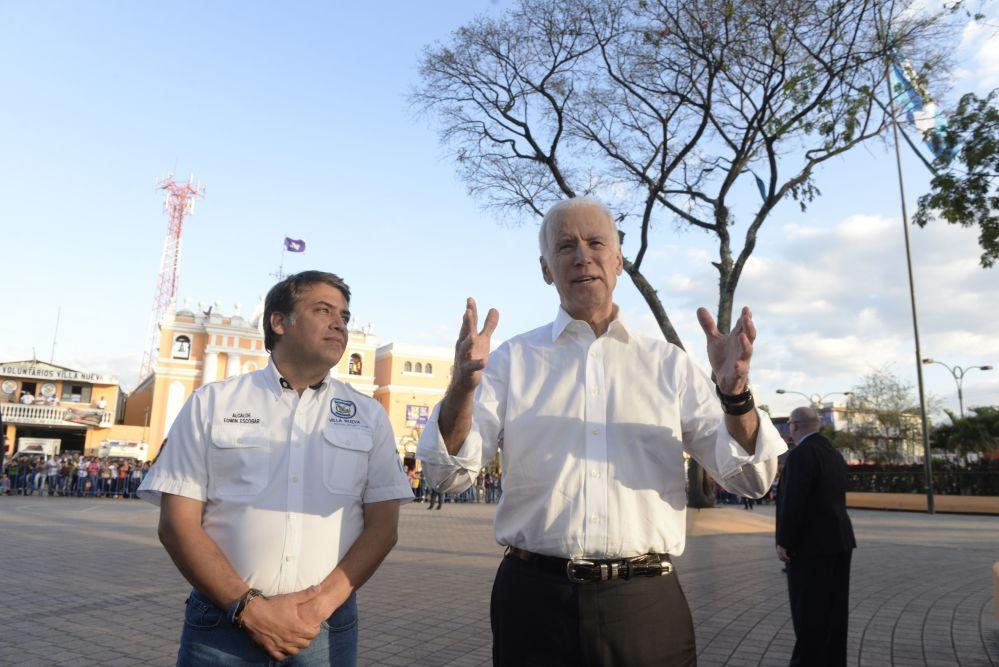 U.S. Vice-President Joe Biden (R) speaks with Edwin Escobar (L), the mayor of Villa Nueva, a suburb outside of Guatemala City, on March 3, 2015.