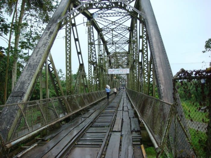 Pedestrians cross the railroad bridge over the Sixaola River, the natural border dividing Panama and Costa Rica, on Aug. 18, 2007.