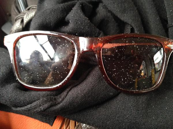 Sunglasses dusted with ash from Turrialba Volcano, in San José, March 12, 2015.