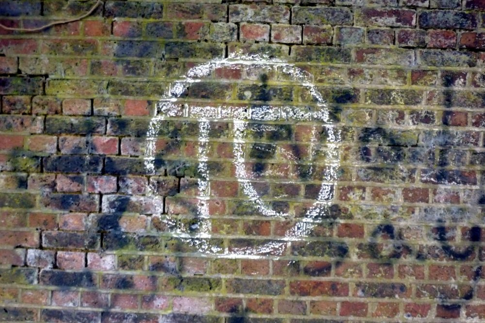 The pi symbol graffitied on a wall in London.