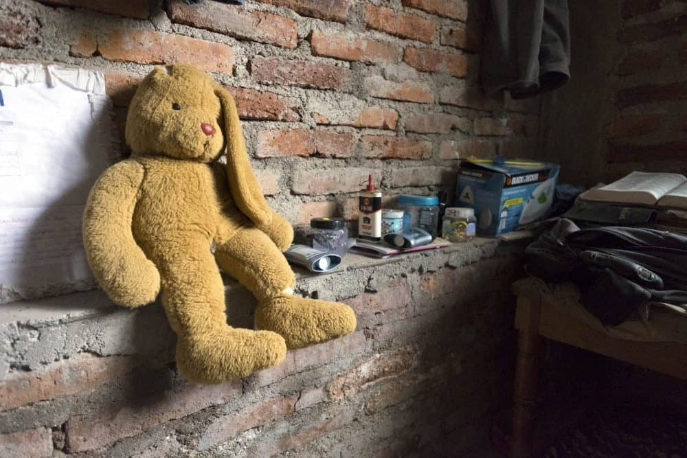 Inside Pedro's room in Matagalpa. An old stuffed rabbit sits on the wall.
