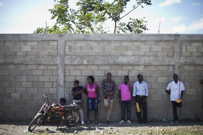 Job seekers wait to enter in Caracol Industrial Park, in Caracol, Haiti.