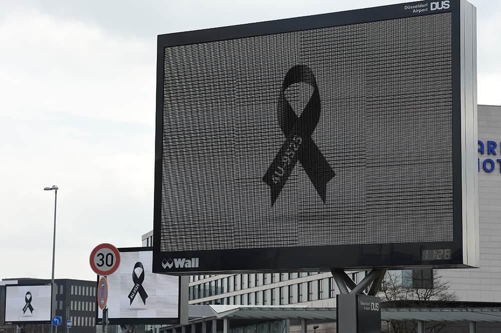 A LCD display shows a black ribbon with the flightnumber of Germanwings 4U 9525 at the Duesseldorf airport on March 26, 2015 in Duesseldorf, western Germany.