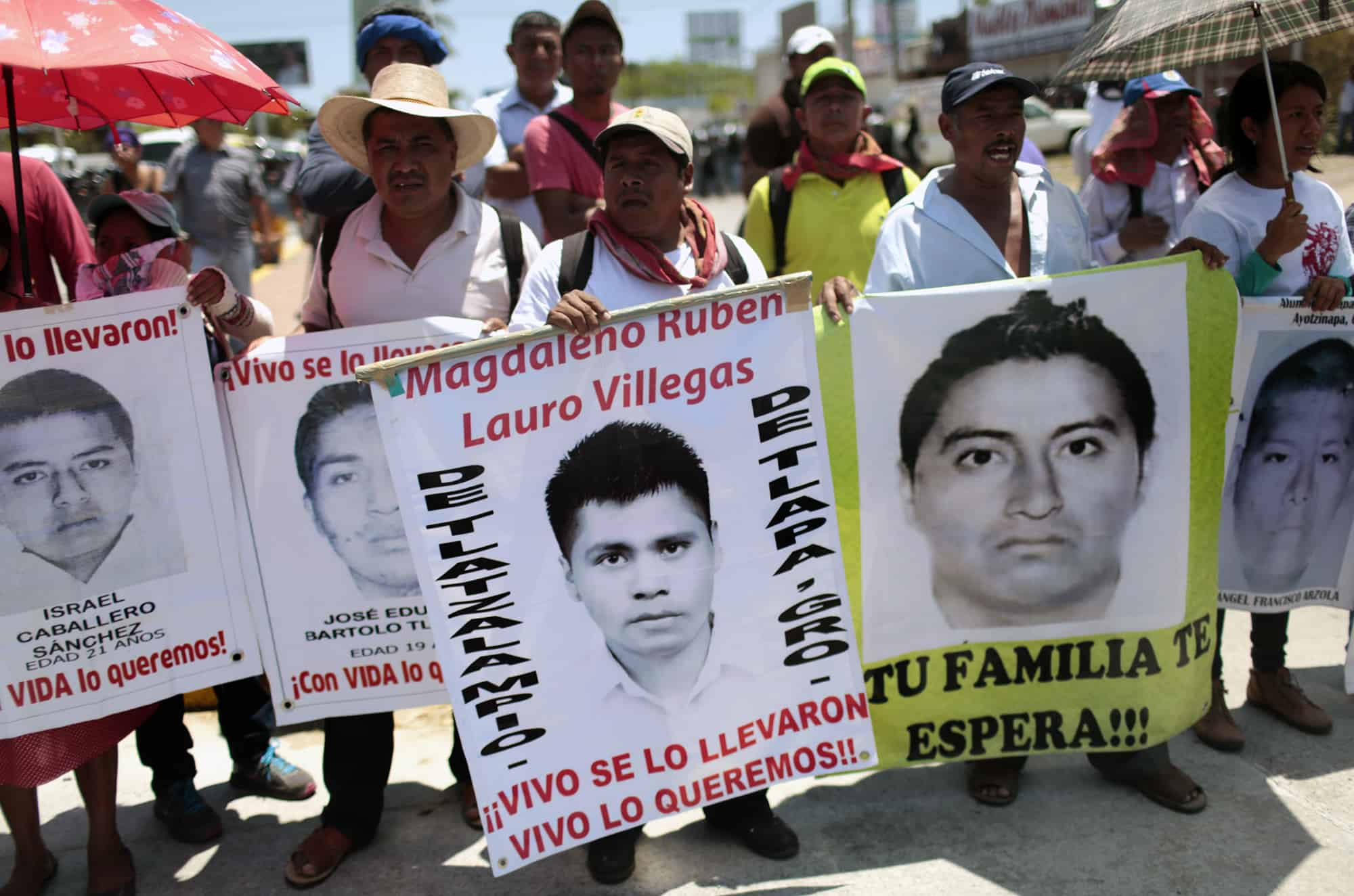 Parents and relatives of the 43 students from Ayotzinapa participate in a protest in Acapulco, Guerrero State, Mexico on March 24, 2015 demanding justice on their disappearance and on the death of teacher Claudio Castillo killed during a protest on February 24.