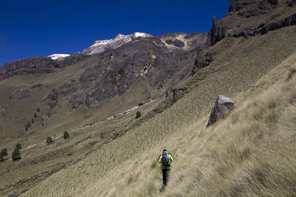 A guard walks along the slopes of IztaccÌhuatl mountain in the Izta-Popo National Park, Mexico on October 29, 2014. The graciars that crown IztaccÌhuatl are considered by experts as doomed to disappear in 10 years due to global warming.