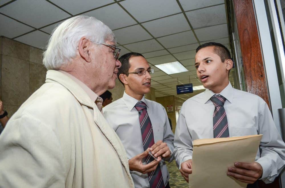 From left, Diversity Movement President Marco Castillo, Lorenzo Serrano and Alberto González at the San José tribunals. Castillo and Serrano's application for a common law marriage was denied by a family court judge in 2014.