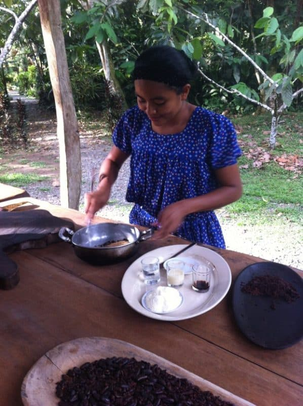 Eunice, an indigenous Teribe, whips up some chocolate during a tour of the Museo de Cacao in Cahuita, Costa Rica.