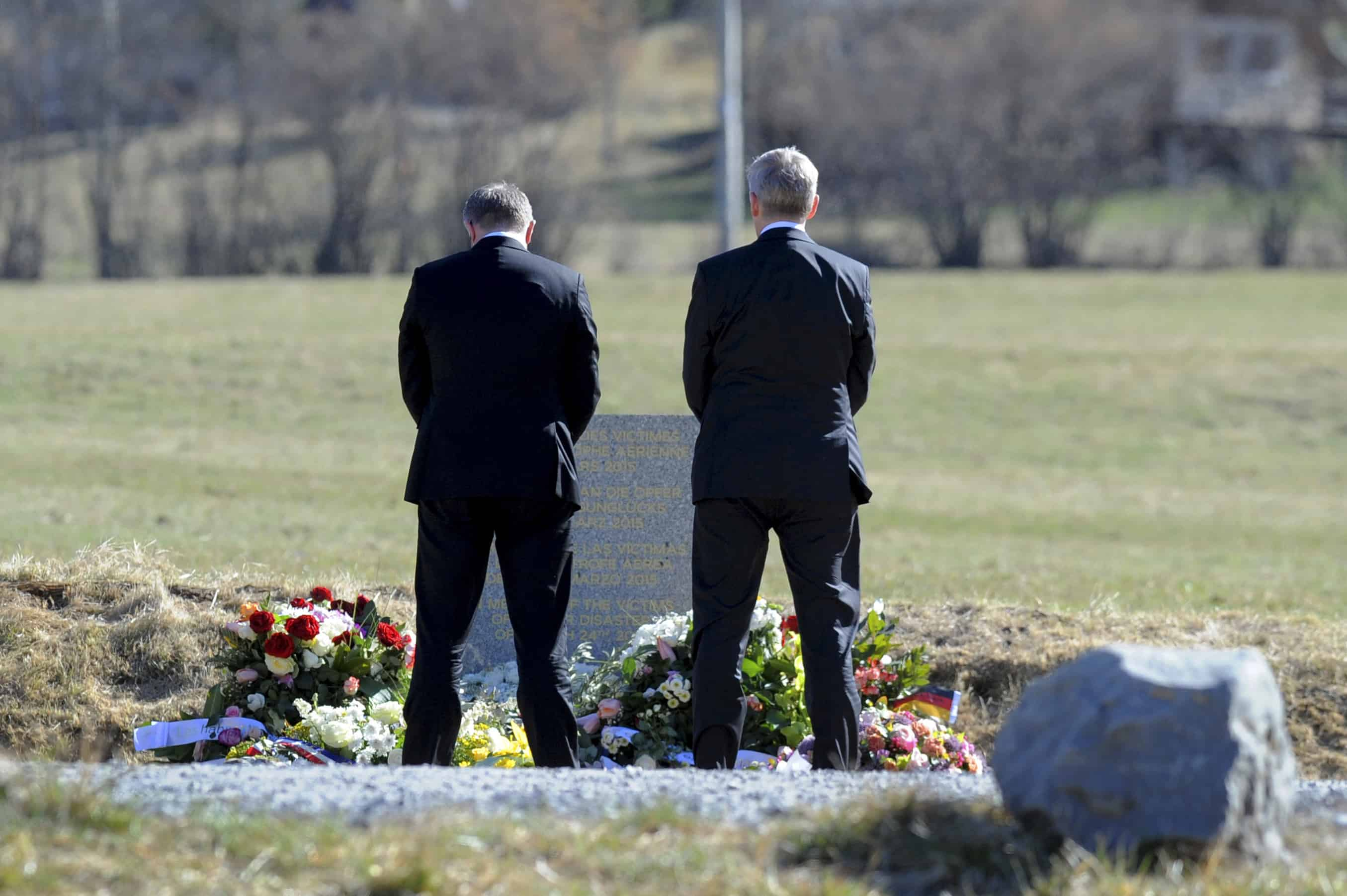 Lufthansa CEO Carsten Spohr, left, and Germanwings CEO Thomas Winkelmann lay a wreath near a stele in memory of the victims of the Germanwings Airbus A320 crash.