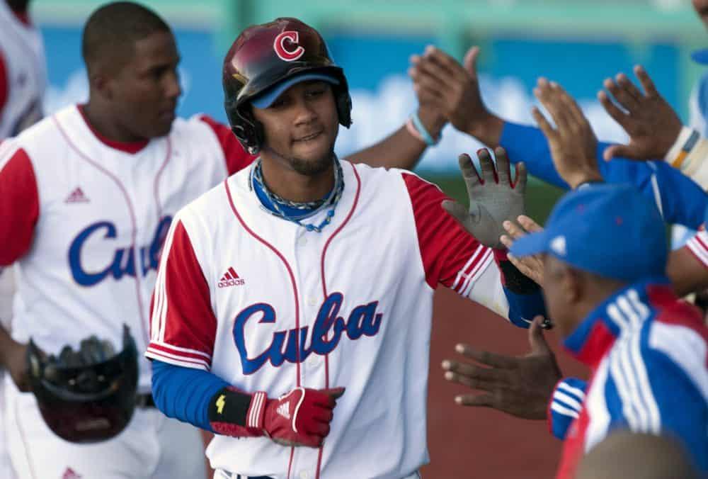 Cuban Yulieski Gourriel celebrates with his teammates after a home run.