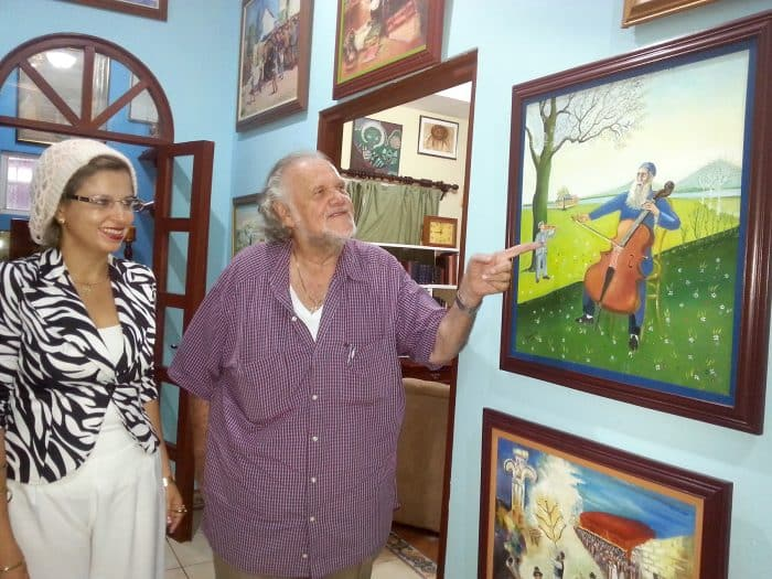 At the Preiss home in Granada, Nicaragua, Veronica and Kurt display their Jewish-themed artwork.