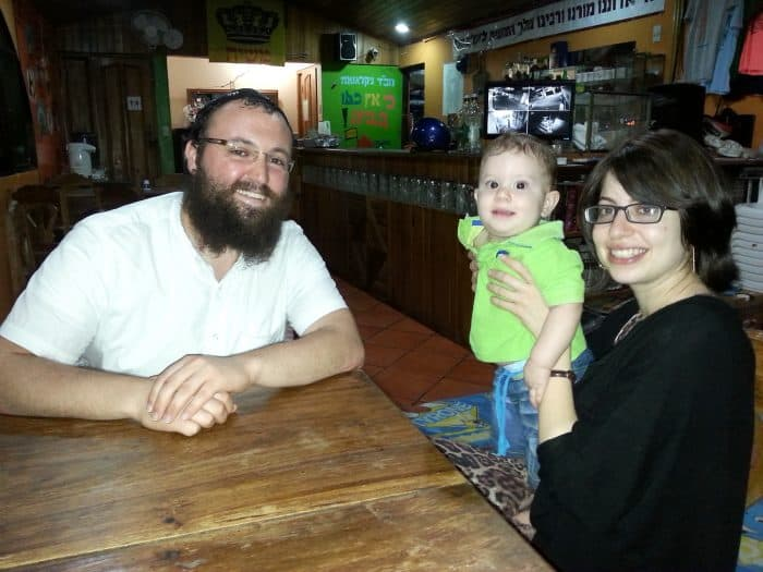 Rabbi David Atar, left, Rebbetzin Chana Atar, right, and their son,Levy Itzhak.