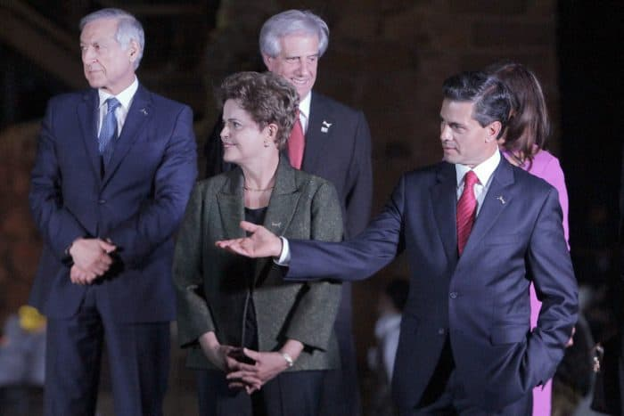 Mexican President Enrique Peña Nieto, right, talks to Brazil's President Dilma Rousseff while Chilean Foreign Minister Heraldo Munoz, left, and Uruguay's President Tabare Vázquez look on.