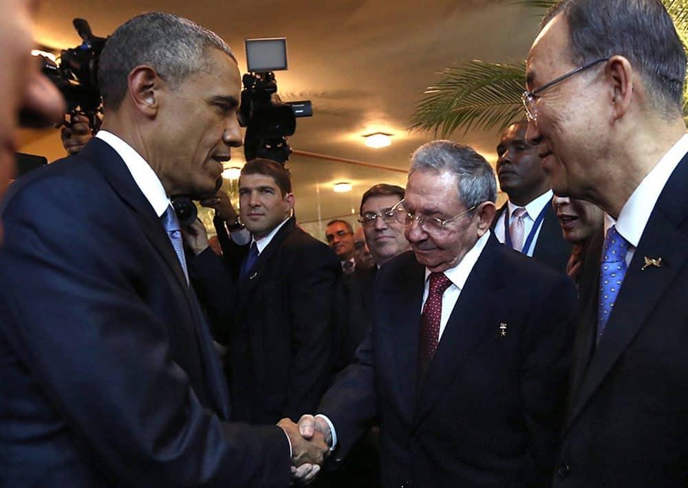Cuban President Raúl Castro, second right, and U.S. President Barack Obama, left, shake hands.