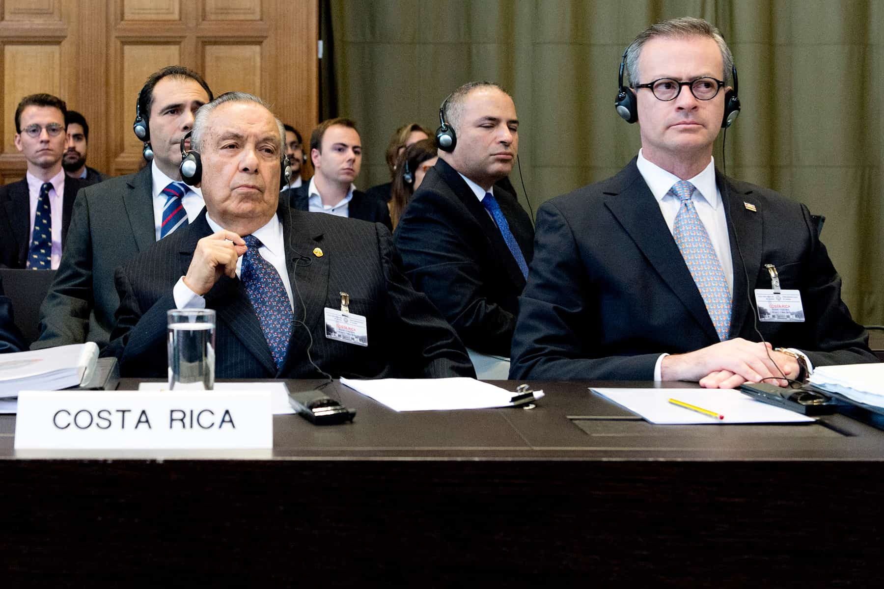 Costa Rica's representative before The Hague, Édgar Ugalde Álvarez (L), and Foreign Minister Manuel González Sánz (R) attend oral hearings at the International Court of Justice, April 21, 2015.