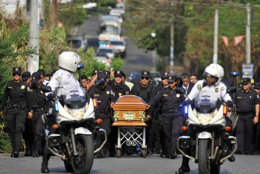 Members of El Salvador's police force attend the funeral of Wendy Yamileth Alfaro Mena, in Zacatecoluca, 65 km east from San Salvador on April 22, 2015.