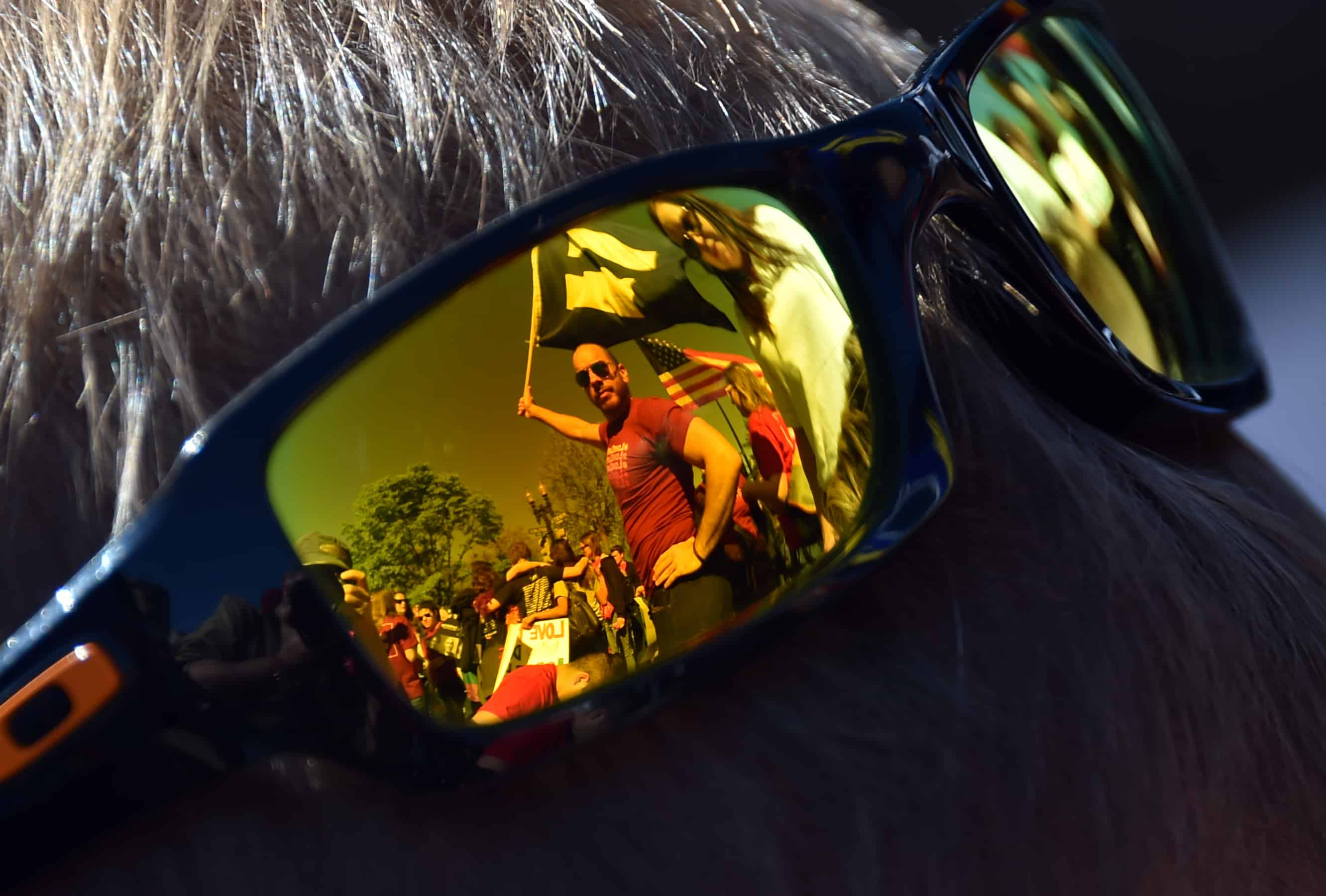 Sunglasses reflect supporters of same-sex marriages standing outside the U.S. Supreme Court as they wait for its decision on whether gay couples have a constitutional right to wed, April 28, 2014 in Washington, D.C.