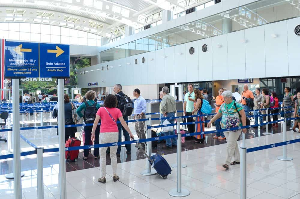 Travelers pass through security at Costa Rica's Juan Santamaría International Airport.