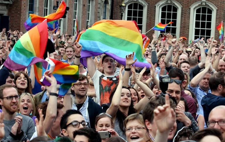 Supporters react outside Dublin Castle following the announcement of the result of the same-sex marriage referendum in Dublin on May 23, 2015.