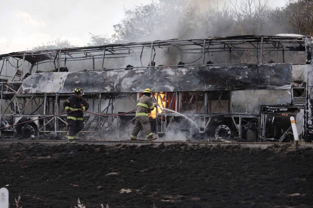 Firefighters extinguish a burning bus in Mexico.