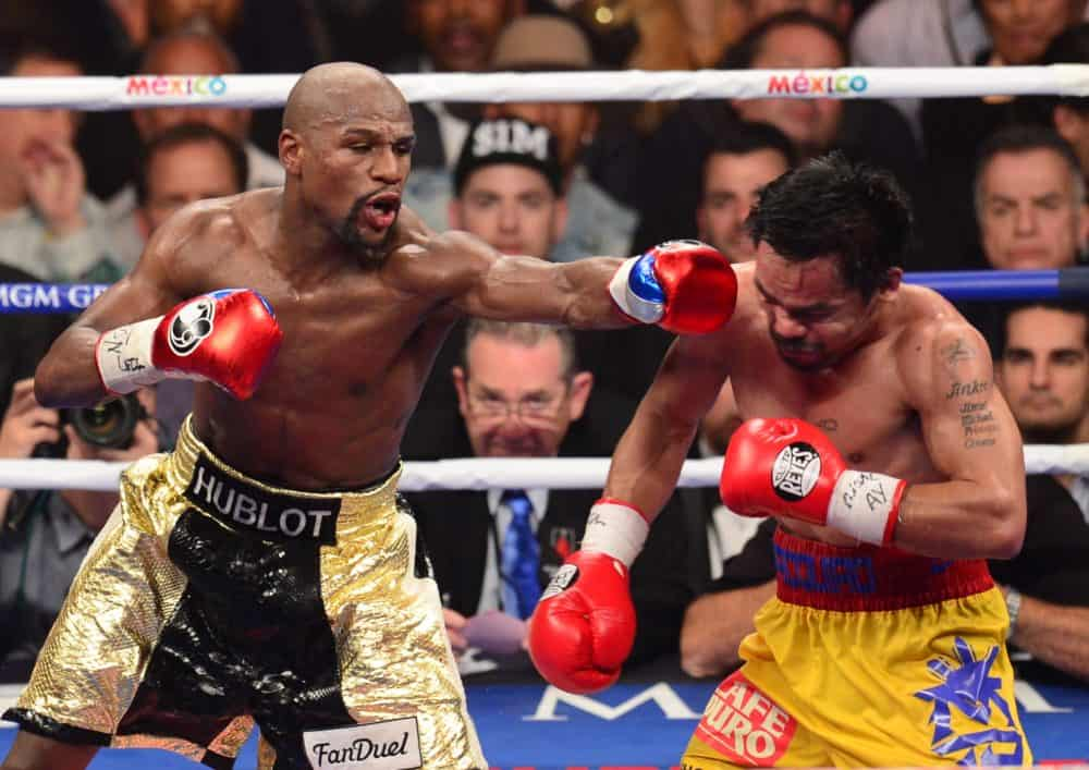 Floyd Mayweather Jr., left, connects against Manny Pacquiao.