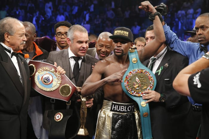 Floyd Mayweather Jr. celebrates after defeating Manny Pacquiao.