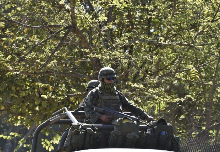 Soldiers of the 88th infantry brigade patrol the area around the site where a military helicopter was shot down.